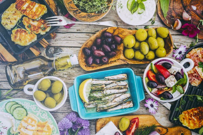 Greek dishes with mandatory olives © gorillaimages - Shutterstock