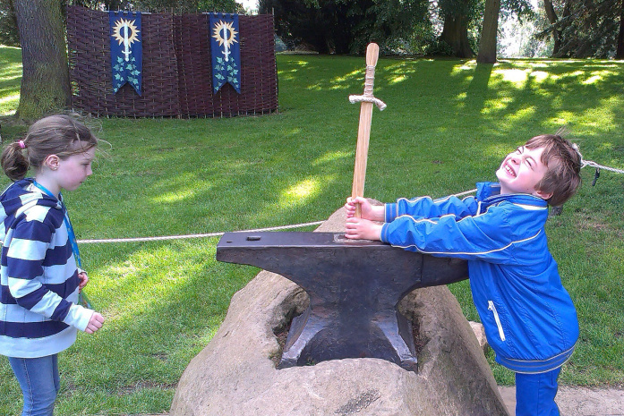 Pulling the sword from the anvil at Warwick Castle -© David Else - Lonely Planet