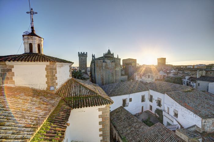 Sunset view across the rooftops of picturesque Cáceres © Luis Davilla - Getty Images